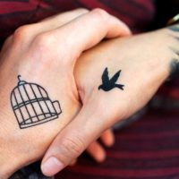 bird and cage tattoo