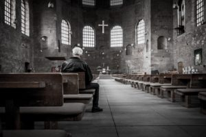 Man alone in church
