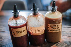 Three bottles of bbq sauce