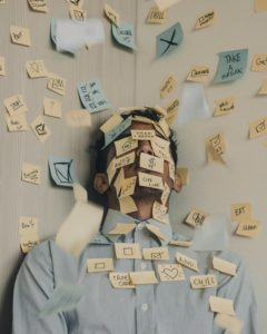 Man covered with Post It notes