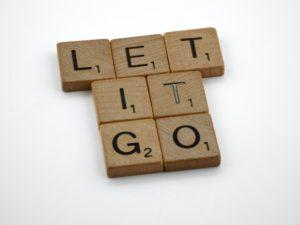 """Scrabble tiles say """"Let it Go"""""""